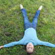 The girl lays on a green grass — Stock Photo #1447592
