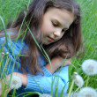 Stock Photo: Young girl relaxing in grass