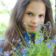 Stok fotoğraf: Young girl relaxing in the grass