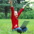 Success girl on a laptop in green grass — Foto Stock