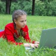 Pretty young girl with a modern laptop — Stock Photo #1447780