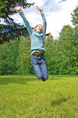 Jumping happy girl — Stockfoto