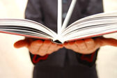 Two hands hold the open book — Stock Photo
