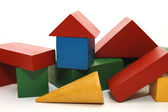 Building from wooden childrens blocks — Stock Photo