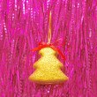 Royalty-Free Stock Photo: Christmas ornament against from a tinsel