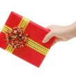 Box with a gift in a hand — Stock Photo