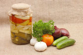 Fresh and tinned vegetables on a sacking — Stock Photo