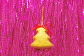 Christmas ornament against from a tinsel — Stockfoto
