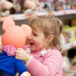 The little girl with a toy — Stock Photo