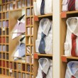 Stock Photo: Shelf with men wear in shop
