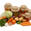 Stock Photo: Fresh and tinned vegetables isolated
