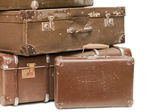 Heap of old suitcases isolated on white — Stock Photo