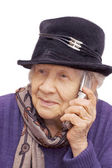 Grandmother talking with a mobile phone — Stock Photo