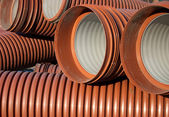 The orange goffered pipe close-up — Stock Photo