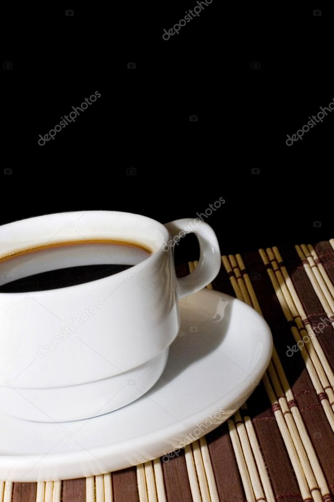 Cup from coffee on a bamboo rug — Stock Photo #2447774