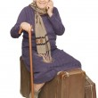 The old lady sits on a suitcase — Stock Photo #2470636