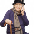 Grandmother talking with a mobile phone — Stock Photo #2470656