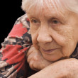 The sad old woman on the black — Stock Photo #2470848