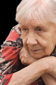 The sad old woman on the black — Stock Photo