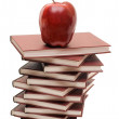 Stack of books and apple isolated - Stock Photo