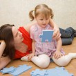 Mum with the daughter play to a room — Stock Photo