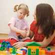 Mum with the daughter play to a room — Stock Photo #2490835