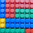 Colored plastic blocks as background — Stock Photo