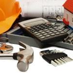 Orange helmet and different tools — Stock Photo