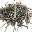 Stock Photo: Heap of nails isolated on white