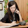 Stock Photo: The beautiful young girl at office