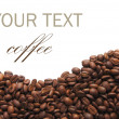 Стоковое фото: Aromatic coffee beans on white