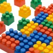 Multi-colored plastic blocks on white — Stock Photo