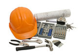 Orange helmet and different tools — Stock Photo