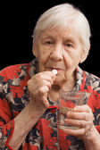 The old woman drinks a tablet — Stock Photo