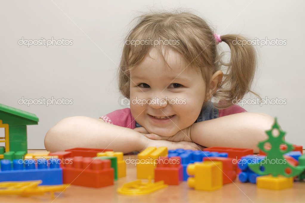 The beautiful girl with toy blocks — Stock Photo #2530879