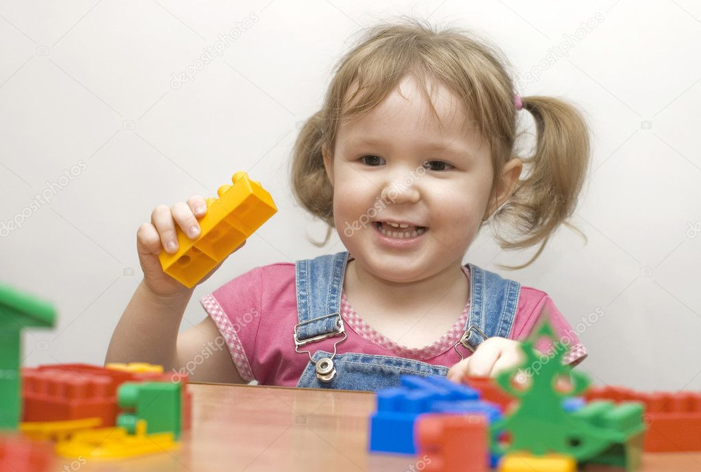The beautiful girl with toy blocks — Stock Photo #2530884
