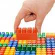 Hand with the toy block isolated — Stock Photo