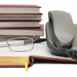 Phone and glasses on the book — Stock Photo