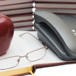 Phone, apple and glasses on the book — Stock Photo