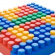 Multi-colored plastic blocks on white — Stock Photo #2543888