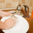 The woman washes ware on kitchen — Stock Photo