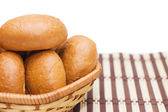 Rolls in a wattled basket isolated — Stock Photo