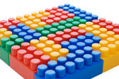 Multi-colored plastic blocks on white — Stock Photo