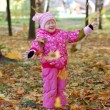 Little girl walks in autumn park — Stock Photo #2554547