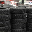 Number of automobile tyres in a market — Stock Photo