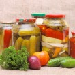 Stock Photo: Fresh and tinned vegetables on a sacking