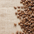 Coffee beans on burlap texture — Stock Photo #2557457