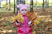 Little girl walks in autumn park — Stock Photo