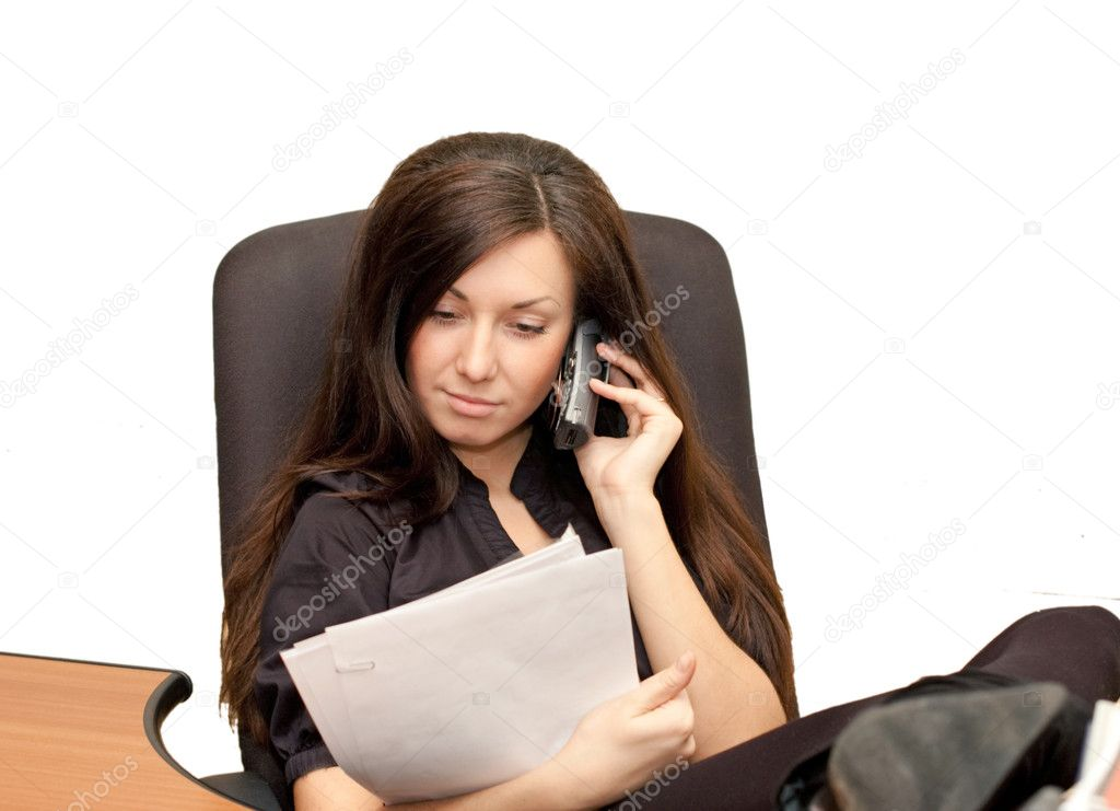 Girl in an armchair with phone — Stock Photo #2557563