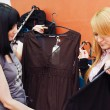 Стоковое фото: Girl chooses clothes in boutique
